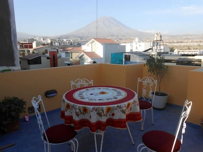 outdoor dining room with view of volcano Misti
