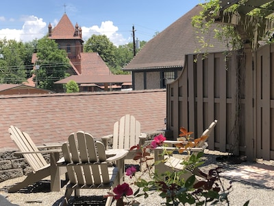 A private terrace overlooking The Cathedral of All Souls & Biltmore Estate prop.