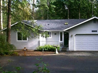 Island Magic -- nestled in the forest and across the street from view in Photo 1