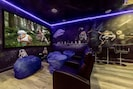 Enjoy movies in your PRIVATE space themed theatre & arcade room!