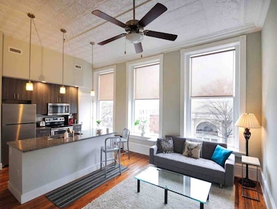 This luxury condo features a gorgeous view of the West Broad Arts District below