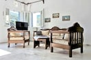 Rustic couch and chairs creates a focal point