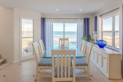 The dining room offers panoramic views of the Gulf. Step out onto the deck to ha