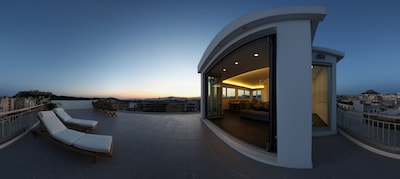 Roof Garden offering the most inspiring views of the Parthenon and the historic centre of Athens, as well as the seaside, the Saronic Islands and the Athenian hills ( Lycabettus, Philopappos and mountains (Hymettos)
