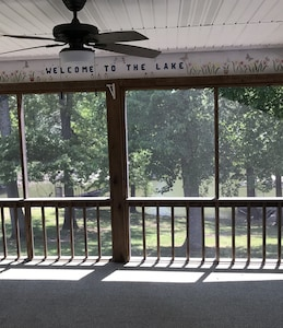Screened-in porch overlooking lake