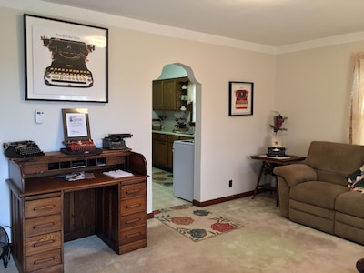 The antique writing desk is the main feature of the living room.