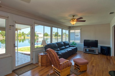 Spacious open family room overlooking canal