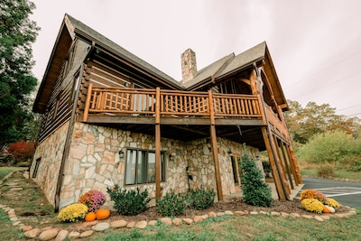 Front of cabin nicely decorated for the Fall