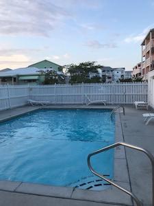 Pool behind condo.