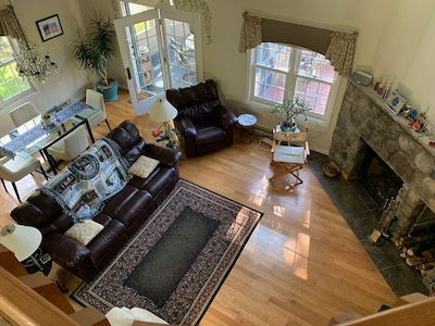 Living and dining rooms, looking down from balcony
