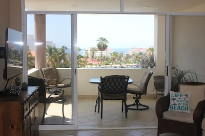 Enjoy the beautiful ocean view with a living area that expands to the outside
