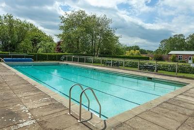 Large, seasonal, heated swimming pool