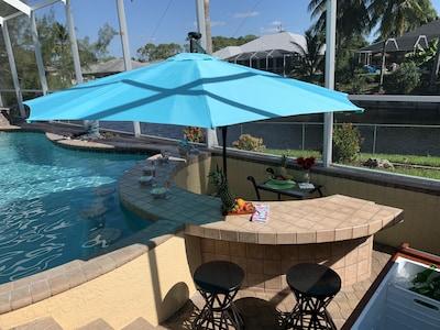 Pool bar seating under an umbrella