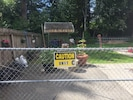 Caution sign on large gate. Entrance to yard