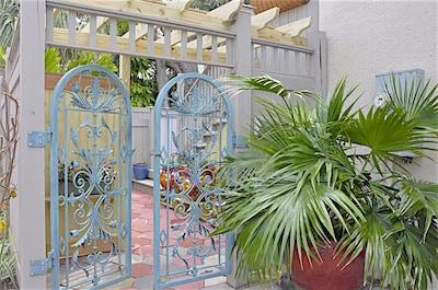 Enter courtyard through antique verdigris gates just off Beach Drive.