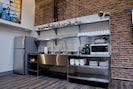The kitchenette is equipped with all the essentials and induction cooktops.