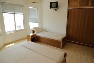 Private Room for 3 persons equipped with one double and one single bed ,
