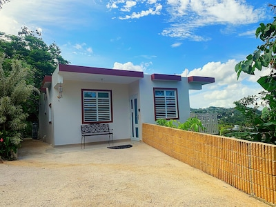 House is about an hour away from San Juan, as such renting a car is recommended.