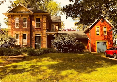 Built in 1897, this lovely Victorian home sits on a large village lot surrounded by 120 year old maple trees