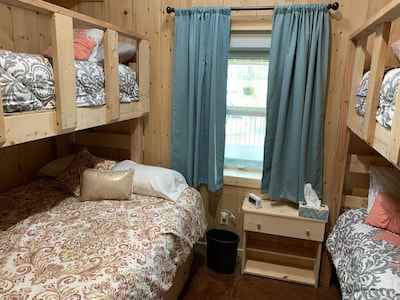 Queen size bed with upper twin and double twin bunk each bedroom