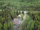 Front, aerial view of the cabin. Upper Paradise Log Cabin is in the background.