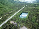 Aerial view of the property showing the Moose Pass Swimming Hole.