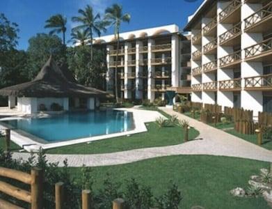 Edifício Costa Oeste Marina Flat  apto 2 suítes decorado frente mar