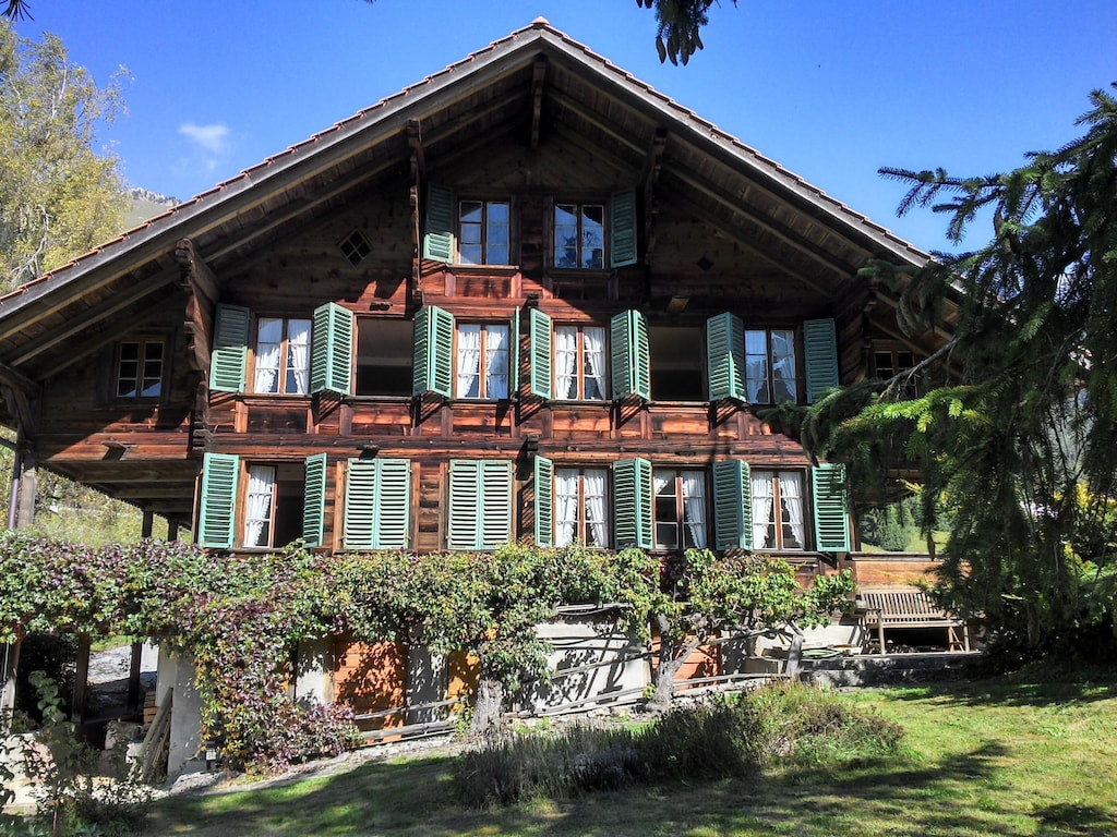 farm stays switzerland | charming farmhouse with a pool, oberwil im simmental