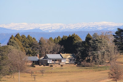 View of Property From House Paddock With Snowy Mountain Backdrop