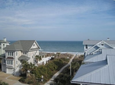 A view from the widow's walk on top of the house.  Picnic table located on deck.