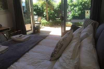 Bedroom opens out to garden