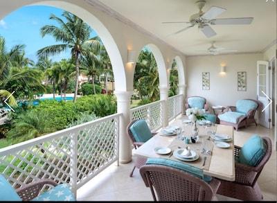 Large balcony overlooking pool and gardens.