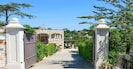 Private gated entrance to 150 sqm Villa Carlotta located on ground floor