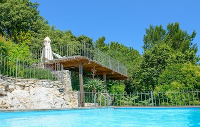 The beautiful private heated pool with sun terrace and dining terraces above