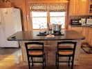 Kitchen with full size gas range, side-by-side refrigerator , microwave and MORE