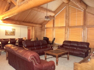 Great room with 3 leather sofas, piano and HDTV