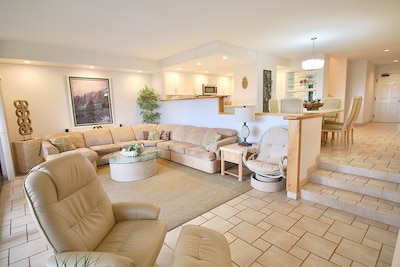 Relax, large sectional couch, open living concepts, entertainment center.