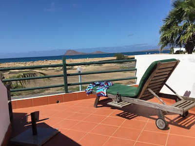 Hibiscus House roof terrace with views over Murdeira Bay