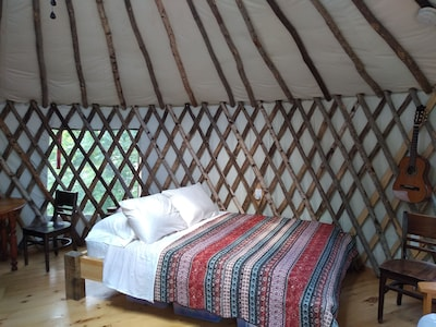 Wild Acres Yurt on 36 acres bordering 800 acres of perserve with a 300 acre pond