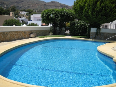 our sparkling, sheltered pool, open all year round , sun chairs supplied in apar
