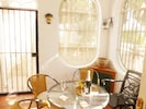 sunroom without glass so cool in summer and sheltered in winter.