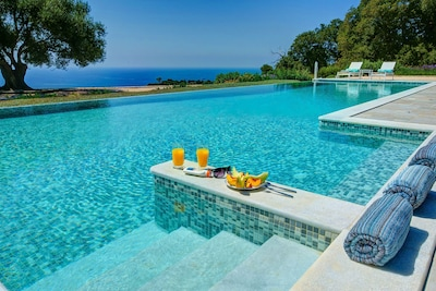 Poolside paradise in the 15m x 5m mosaic tiled, infinity pool with Jacuzzi.