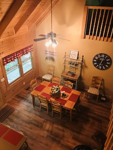 Lovely dining room open to the family room that seats eight.