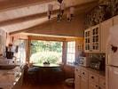 Eat in Kitchen with all amenities - wood floor, D/W, fun wallpaper