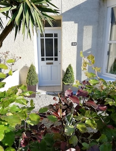 No. 24 is a spacious family home, within a 5 min walk to a dog friendly beach.