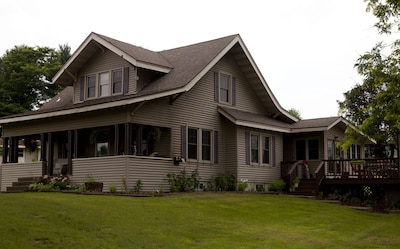 View of our home from the driveway entry.  Guest suite is our second story with 3 spacious rooms,  over 600 square feet and 5 windows.