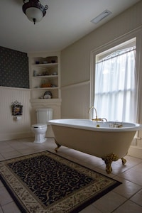 En suite bathroom with claw foot tub and steam shower in bedroom number 1