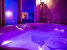Hot Tub is located right outside the Living Room door in a private-gated area.