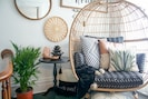 Curl up in the cozy egg chair on your indoor porch/landing area - time to relax!