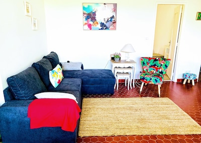 Comfortable living room for relaxing after active days out, with pull out sofa